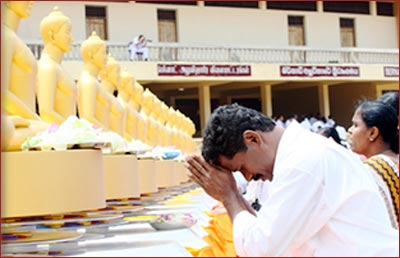 The way Buddhists worship the Lord Buddha is by bowing.